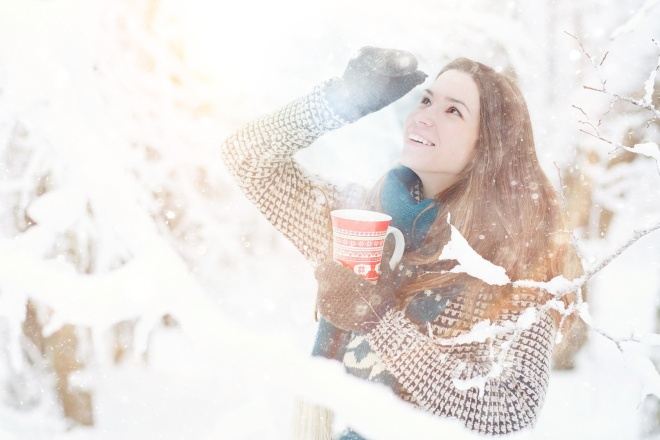girl outside winter with cup of hot drink